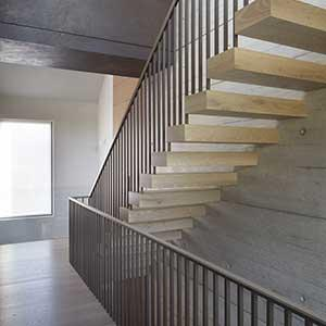 Kenwood Lee House - photo showing cantilevered stairs in the house