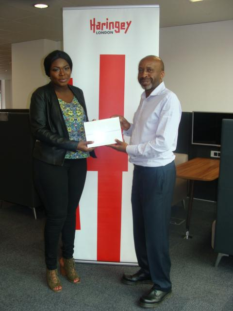 Jennifer Asenso receiving her iPad from Cllr Jospeh Ejiofor