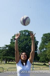 young woman playing netball