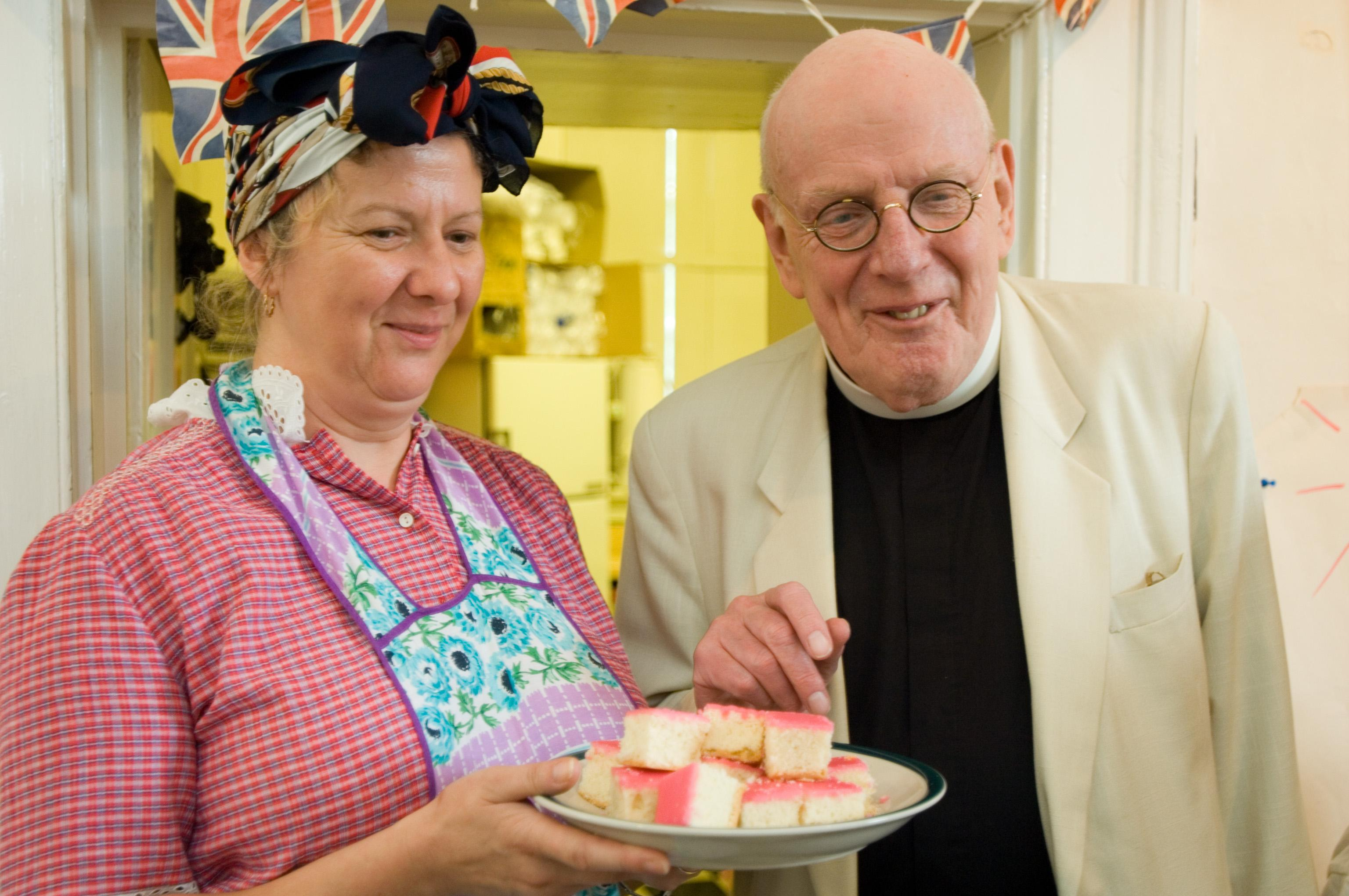 Frank Williams the Vicar of Dad's Army eating Tottenham Cake at Bruce Castle