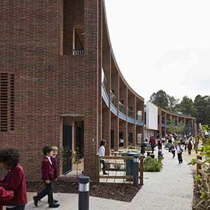 Highgate School -  photo of curving west facade looking over sports fields