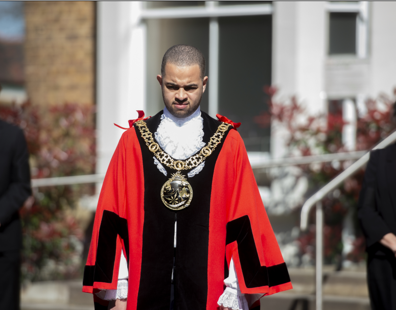 The Mayor of Haringey, Cllr Adam Jogee, observes the national minute's silence for HRH Prince Philip, the Duke of Edinburgh.