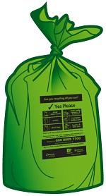 Green plastic sack tied up containing recycling